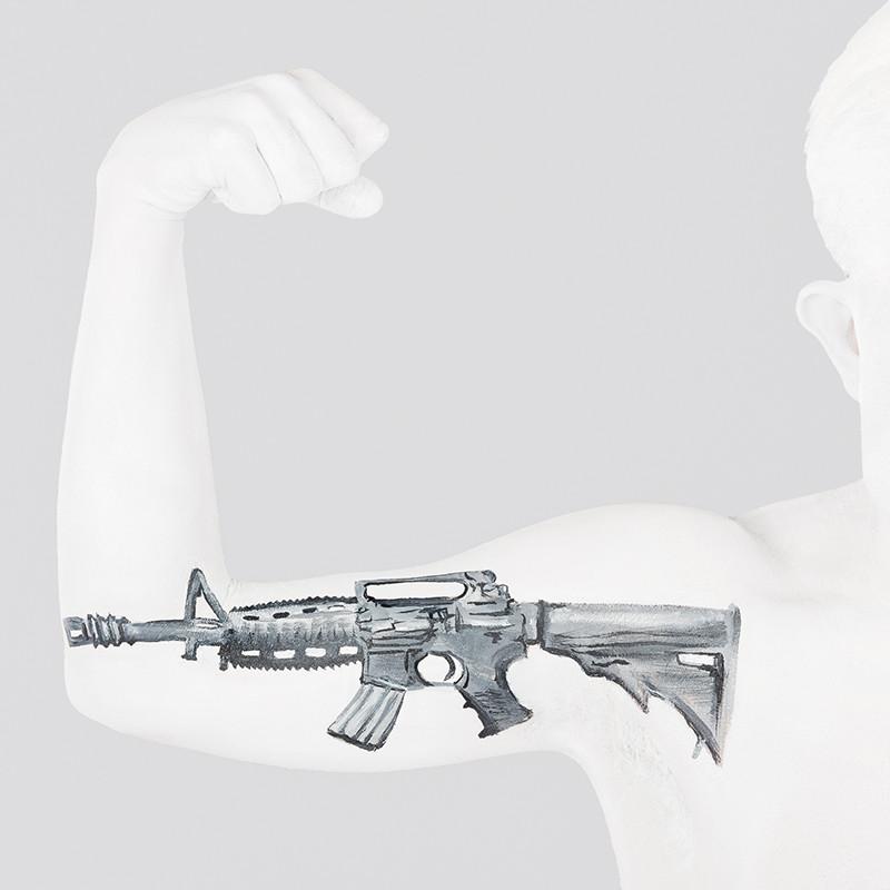 Guns Emma Fay Ridiculous exhibition model: Adam Pearson Photographer: Johnathan Macauley
