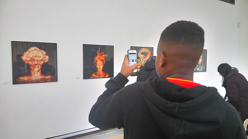A gentlemen photographs 'Burn out' as part of the portraits of the mind exhibition